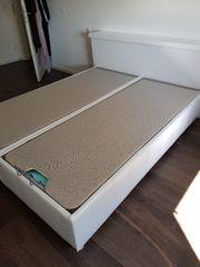 Doppelbett mit großem Stauraum von