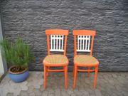 2 Holzstühle Stühle orange geflochten