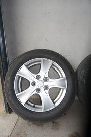 4 Winterreifen Bridgestone ALU-Felgen von