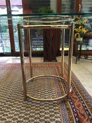 Glastisch mit goldenem