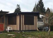 Wohnwagen mit Zelt u a