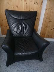 Leder Sessel mit Hocker schwarz