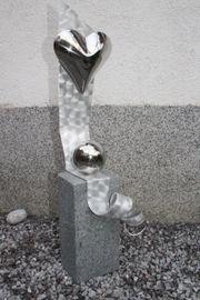 Skulptur Edelstahlherz trifft