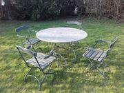 Gartengarnitur - runder Steintisch mit 4