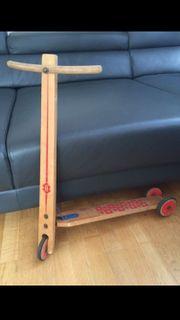 alter Holz-Tretroller