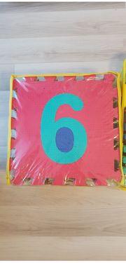 kinder schaumpuzzle Zahlen und Buchstaben