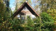 Ferienhaus mit Kamin im Wald